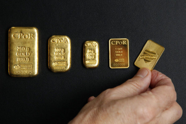 Gold bars weighing between one ounce and 500 grams are displayed in an office of French gold supplier CPoR Devises company in Paris
