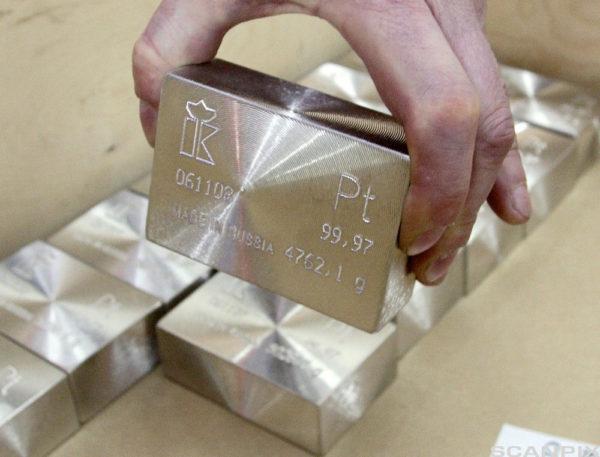 A worker puts an ingot of platinum into a box at the Krastsvetmet nonferrous metal plant in Krasnoyarsk